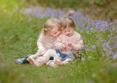Young sisters sit amongst bluebells on a family photo shoot - tunbridge wells photography blog