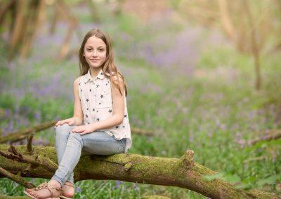 Girl in bluebell wood - family photographer tunbridge wells